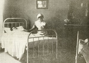 A nurse inside Northfield Hospital, about 1915