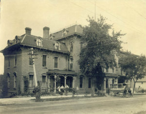 The hotel's name changed to the Manawa Hotel, which can be seen in the wagon parked out front in 1890.