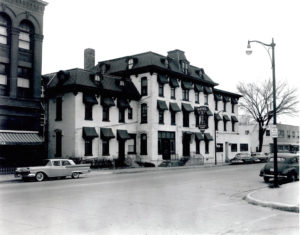 At one point the hotel's bricks were painted white, which you can see in this photo of the Hotel Stuart in 1959.