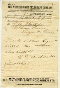 Telegram to First National Bank cashier G. M. Phillips with news about the bank raid, Sept. 7, 1876.