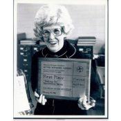 Maggie Lee with a Minnesota Newspaper Award