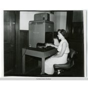 Pat Fink at a Recordak machine, c. 1955