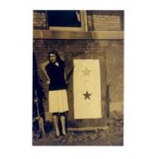 LaVonne Rasmussen with I.O.O.F. Home war service banner, 1943