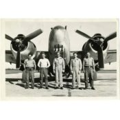 Homer D. Fausch and crewmates with their plane